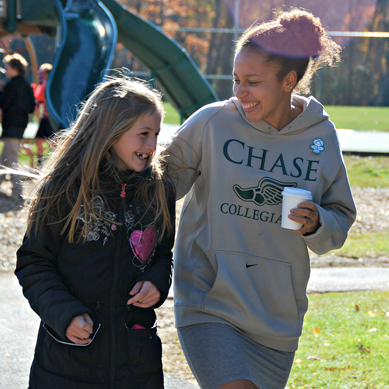 Chase Collegiate students laughing near playground