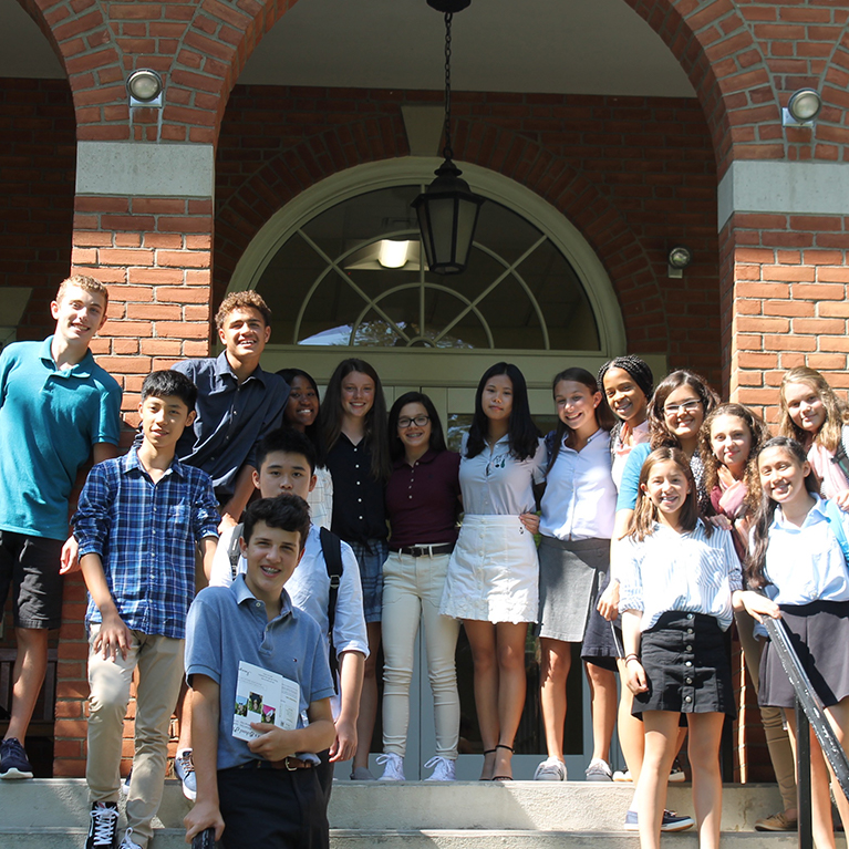 A group of future Chase Collegiate students pose outside while on a tour of the campus.