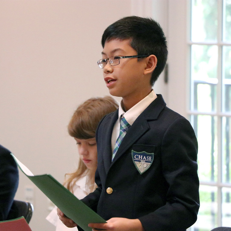 Chase Collegiate student public speaking in class