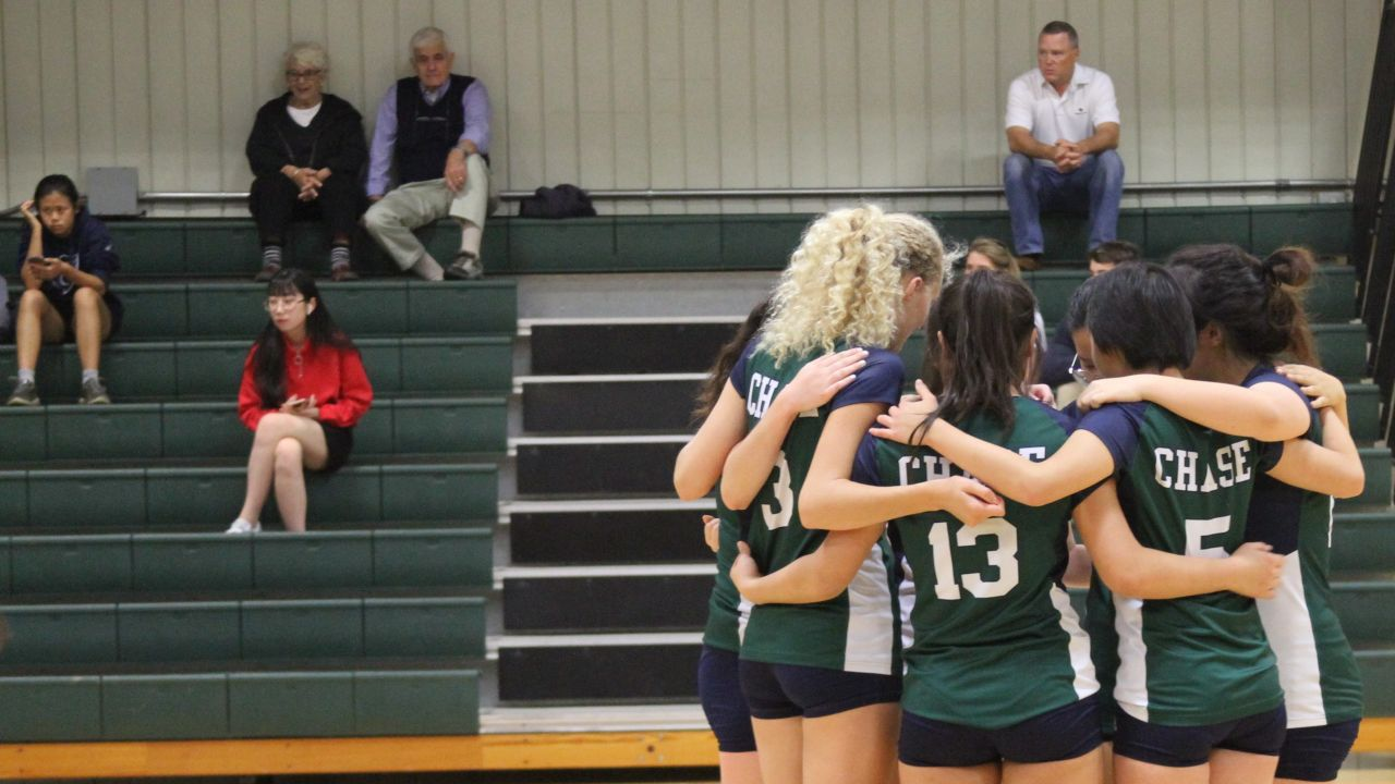 Gilrs Varsity Volleyball Chase Collegiate Huddles During Their Match.jpg