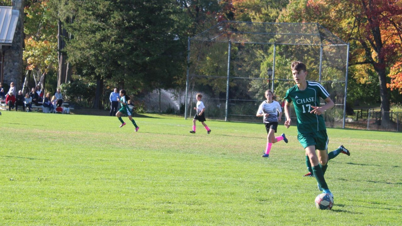 Nick Ciampi Chase Collegiate Dribbles in Middle School Soccer.jpg