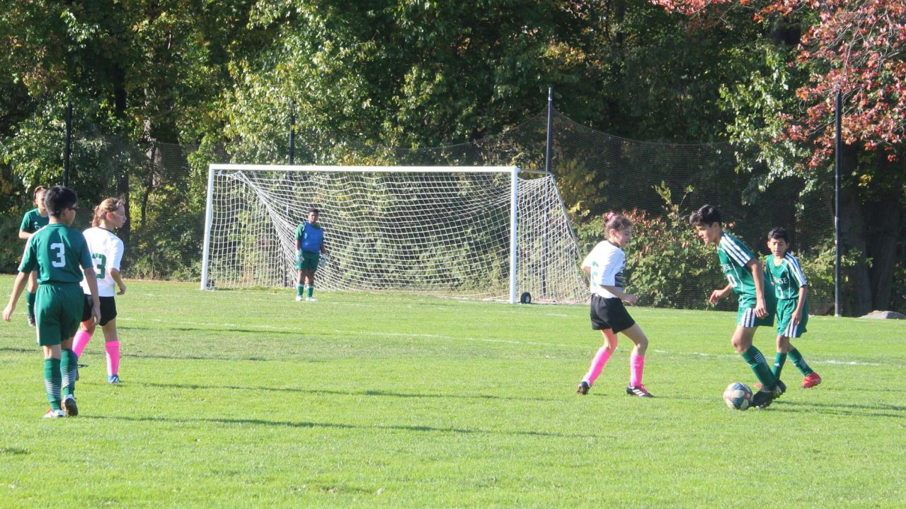 Chase Collegiate MS Soccer Dribbles Against IDS.jpg