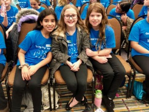 Three Chase Collegiate students sit together at the CMEA All State Conference.jpeg