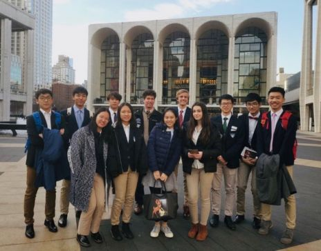 Chase Collegiate students pose outside Lincoln Center after hearing the Philharmonic Orchestra..jpeg