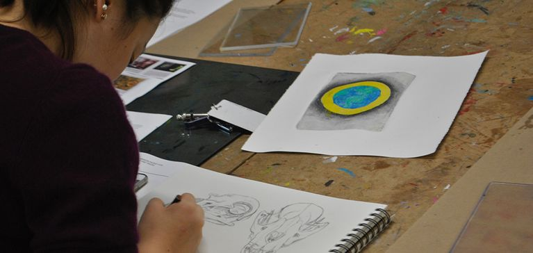 A Chase Collegiate student sketches in her visual arts class.